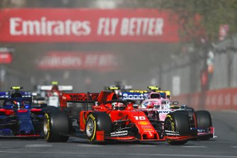 Charles Leclerc, Ferrari SF90, leads Lance Stroll, Racing Point RP19, Alexander Albon, Toro Rosso STR14, and the remainder of the field