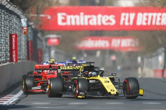 Daniel Ricciardo, Renault R.S.19, leads Charles Leclerc, Ferrari SF90