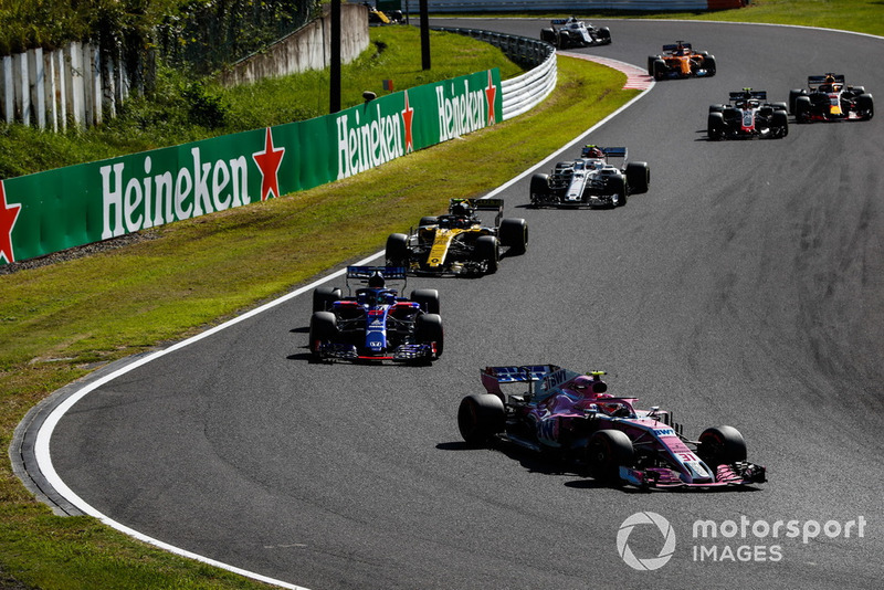 Esteban Ocon, Racing Point Force India VJM11, leads Brendon Hartley, Toro Rosso STR13, Carlos Sainz Jr., Renault Sport F1 Team R.S. 18, Charles Leclerc, Sauber C37, and Kevin Magnussen, Haas F1 Team VF-18