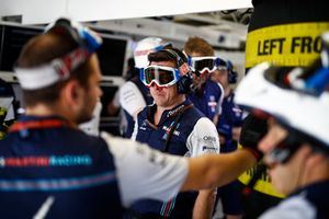 Williams engineers with pit goggles on in the garage