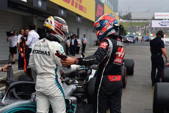 Lewis Hamilton, Mercedes AMG F1 and Romain Grosjean, Haas F1 Team celebrate in parc ferme