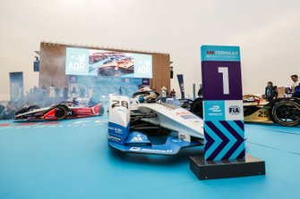 The top three cars of Antonio Felix da Costa, BMW I Andretti Motorsports, BMW iFE.18, Jean-Eric Vergne, DS TECHEETAH, DS E-Tense FE19, Jérôme d'Ambrosio, Mahindra Racing, M5 Electro pull up in front of the podium