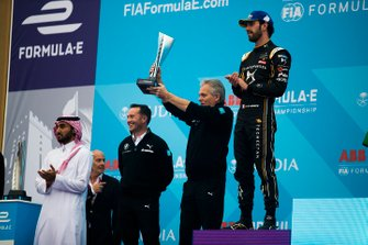 J-F Thormann, President of Andretti Autosport holds aloft the constructors trophy on the podium