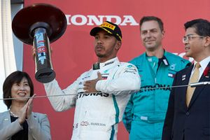 Lewis Hamilton, Mercedes AMG F1, celebrates his win on the podium with his trophy
