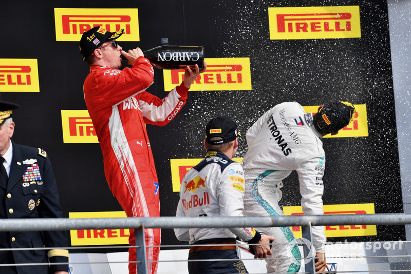 (L to R): Kimi Raikkonen, Ferrari, Max Verstappen, Red Bull Racing and Lewis Hamilton, Mercedes AMG F1 celebrate with the champagne on the podium