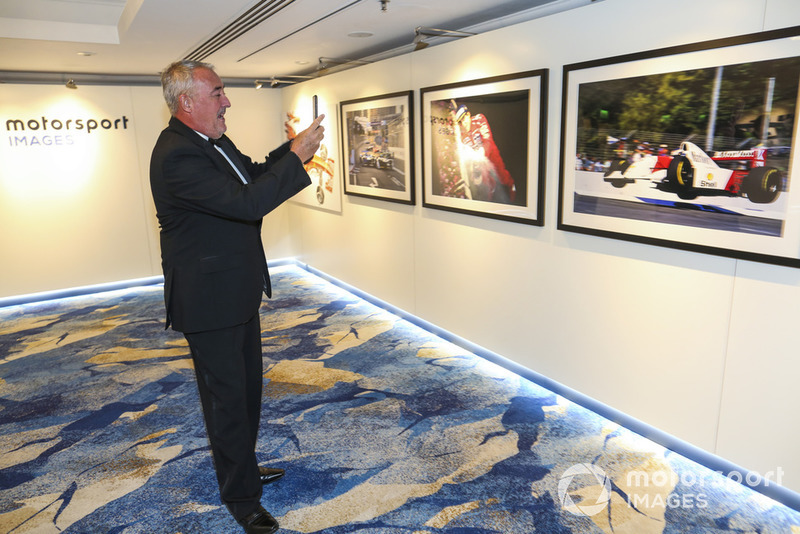 Photographer Mark Sutton at the Motorsport Images display