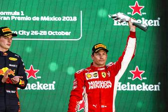 Kimi Raikkonen, Ferrari, 3rd position, lifts his trophy