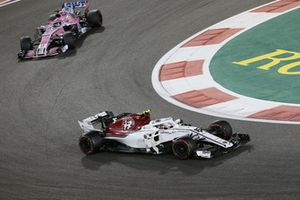 Charles Leclerc, Sauber C37 and Sergio Perez, Racing Point Force India VJM11