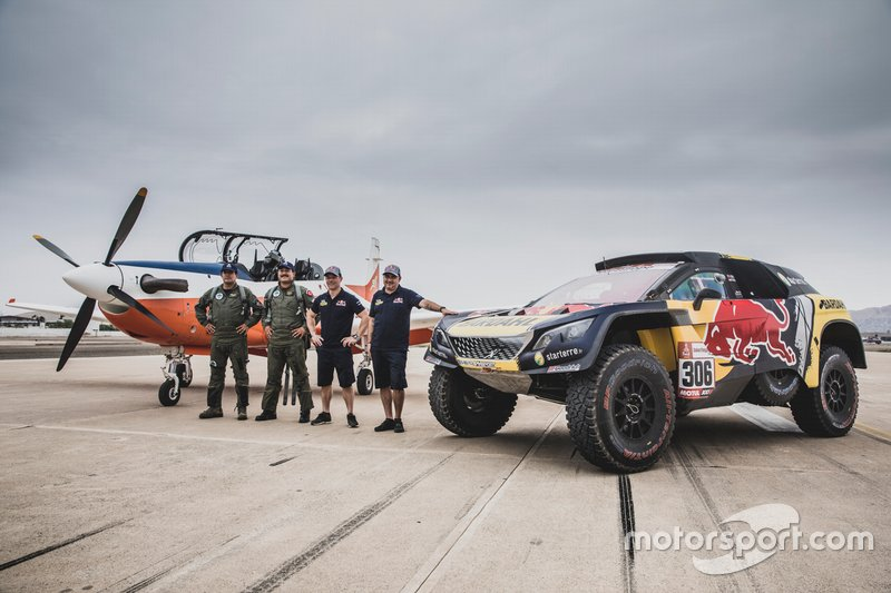 Sebastien Loeb and Daniel Elena of PH Sport after a race with an airplane before the Rally Dakar