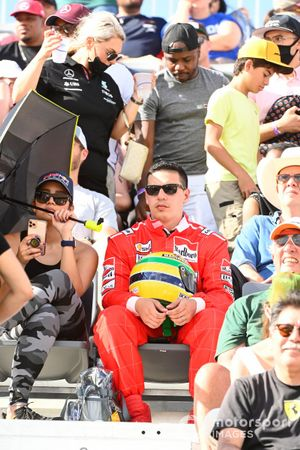 A fan dressed as Ayrton Senna in a grandstand