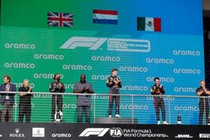 Mohammed Y. Al Qahtani, Aramco, Lewis Hamilton, Mercedes, 2nd position, former basketball star Shaquille O'Neal, Max Verstappen, Red Bull Racing, 1st position, Sergio Perez, Red Bull Racing, 3rd position, and Masashi Yamamoto, General Manager, Honda M