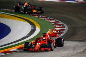 Sebastian Vettel, Ferrari SF71H and Max Verstappen, Red Bull Racing RB14