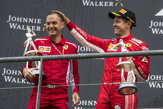 Sebastian Vettel, Ferrari and David Sanchez, Ferrari celebrate on the podium with their trophies