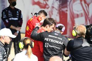 Charles Leclerc, Ferrari, 2nd position, and Lewis Hamilton, Mercedes, 1st position, talk in Parc Ferme