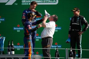 Zak Brown, CEO, McLaren Racing, drinks from the shoe of Daniel Ricciardo, McLaren, 1st position, on the podium