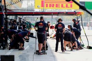 The Red Bull pit crew in the pit lane