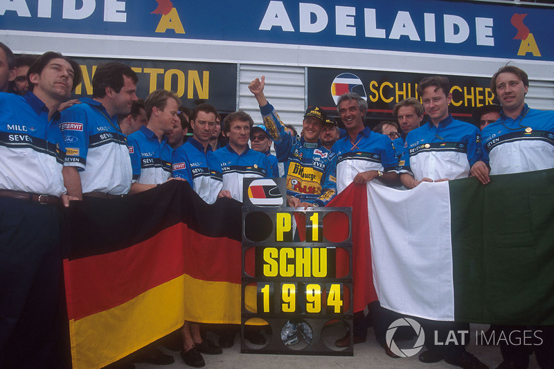 Michael Schumacher celebrates becoming World Champion with Flavio Briatore, Tom Walkinshaw and the r