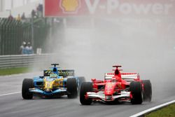 Michael Schumacher, Ferrari 248F1 battles with Giancarlo Fisichella, Renault R26