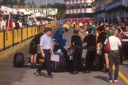 Roberto Moreno jumps out of his Andrea Moda S921 Judd