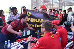 Sebastian Vettel, Ferrari and Kimi Raikkonen, Ferrari sign autographs for the fans