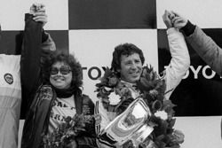 Mario Andretti, Lotus, celebrates winning the World Championship on the podium with his wife Dee Ann Andretti