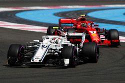 Charles Leclerc, Sauber C37, leads Kimi Raikkonen, Ferrari SF71H