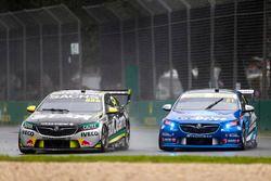 Craig Lowndes, Triple Eight Race Engineering Holden, leads Tim Blanchard, Brad Jones Racing Holden
