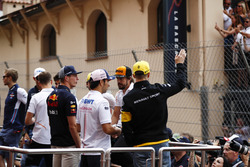 Nico Hulkenberg, Renault Sport F1 Team, waves to fans on the drivers' parade, Sergio Perez, Force India, Max Verstappen, Red Bull Racing, Carlos Sainz Jr., Renault Sport F1 Team, Fernando Alonso, McLaren, Lance Stroll, Williams Racing and Stoffel Vandoorne, McLaren, Esteban Ocon, Force India and Lance Stroll, Williams Racing are also visible