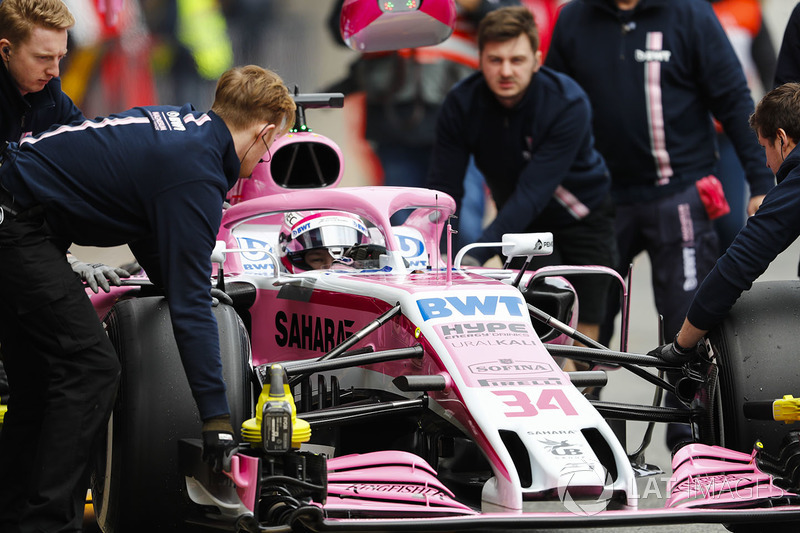 Nikita Mazepin, Force India VJM11, is attended to by mechanics in the pit lane