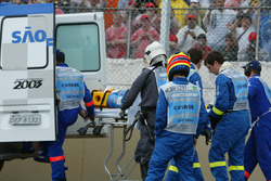 Fernando Alonso, Renault Renault F1 Team, is stretchered away after crashing heavily