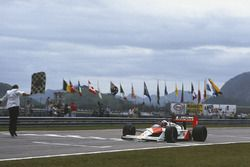 Alain Prost, McLaren MP4/4, takes the chequered flag
