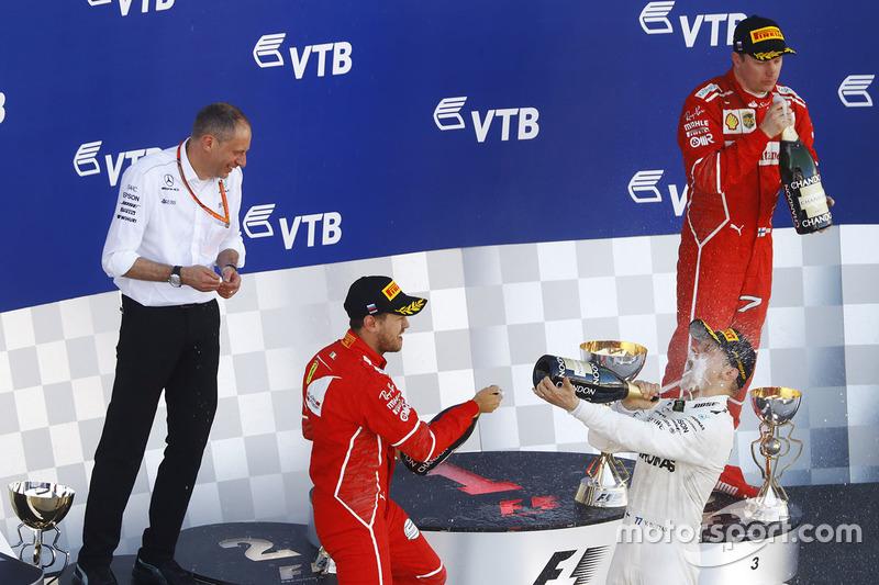 Second place Sebastian Vettel, Ferrari, Race winner Third place Valtteri Bottas, Mercedes AMG F1 Kimi Raikkonen, Ferrari