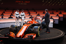 Race drivers Stoffel Vandoorne and Fernando Alonso on stage with presenter Simon Lazenby at the launch of the McLaren MCL32