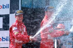 Podium: 1. Michael Schumacher, Ferrari, 2. Eddie Irvine, Ferrari, 3. Mika Hakkinen, McLaren
