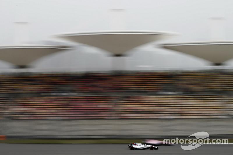 Lance Stroll, Williams FW40, passes Sergio Perez, Force India VJM10