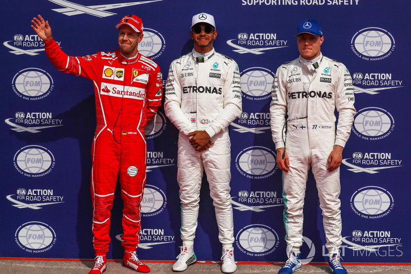 Sebastian Vettel, Ferrari, Polesitter Lewis Hamilton, Mercedes AMG F1 and Valtteri Bottas, Mercedes AMG F1 celebrate in parc ferme