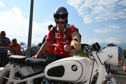 Sebastian Vettel, Ferrari arrives at the track on a vintage BMW motorbike