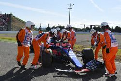 Marshals recover the car of race retiree Carlos Sainz Jr., Scuderia Toro Rosso STR12