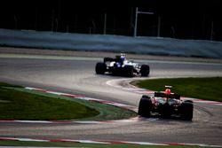 Marcus Ericsson, Sauber C36, leads Max Verstappen, Red Bull Racing RB13