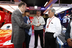 Sean Bratches, Managing Director of Commercial Operations, Formula One Group, Actor Owen Wilson, Ross Brawn, Managing Director of Motorsports, FOM, Chase Carey, Chairman, Formula One, in the Cars 3 promotional garage