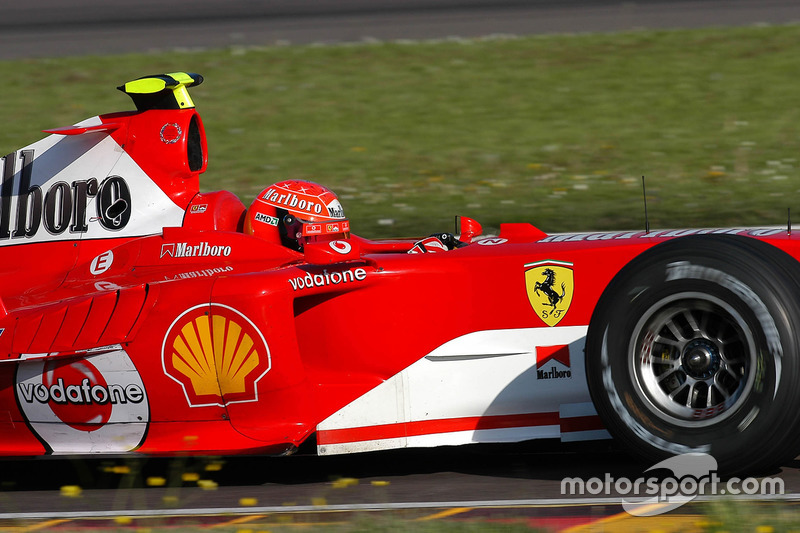Valentino Rossi, wearing one of Schumacher's spare helmets, drives Ferrari F2004 for the first time at Fiorano in April 2004