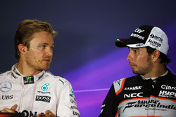 (L to R): Nico Rosberg, Mercedes AMG F1 with Sergio Perez, Sahara Force India F1 in the FIA Press Co