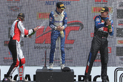 GT Cup podium: race winner Alec Udell, second place Sloan Urry, third place Corey Fergus