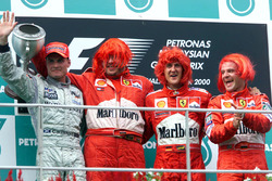 Podium: second place David Coutlhard, McLaren; Ross Brawn, Ferrari; Race winner Michael Schumacher,