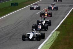 Felipe Massa, Williams FW38 Mercedes, leads Fernando Alonso, McLaren MP4-31 Honda, Nico Hulkenberg, Force India VJM09 Mercedes, and Max Verstappen, Red Bull Racing RB12 TAG Heuer
