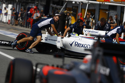 Felipe Massa, Williams FW38 Mercedes, is returned to the garage by engineers