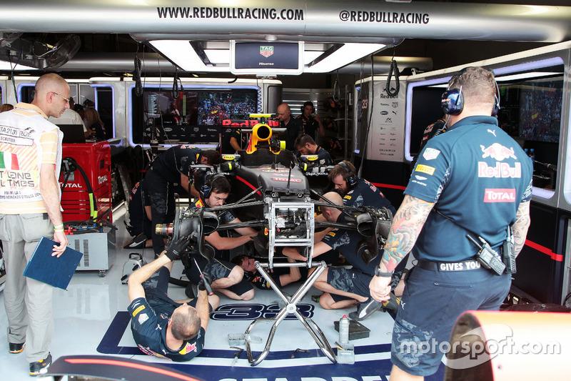 Red Bull Racing mechanics work on the Red Bull Racing RB12 of Max Verstappen,