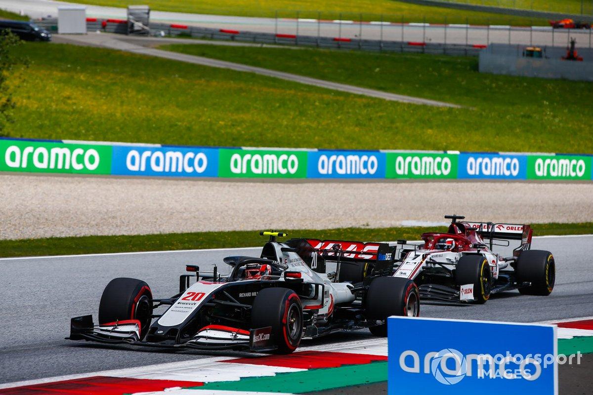 Kevin Magnussen, Haas VF-20, leads Kimi Raikkonen, Alfa Romeo Racing C39