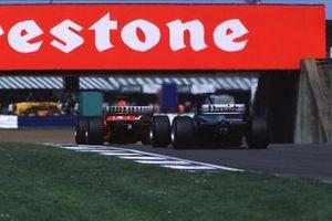 David Coulthard, McLaren MP4/15 Mercedes, Rubens Barrichello, Ferrari F1-2000
