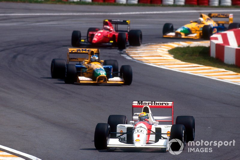 Ayrton Senna, McLaren MP4/7A Honda leads Michael Schumacher, Benetton B191B Ford, Jean Alesi, Ferrari F92A and Martin Brundle, Benetton B191B Ford